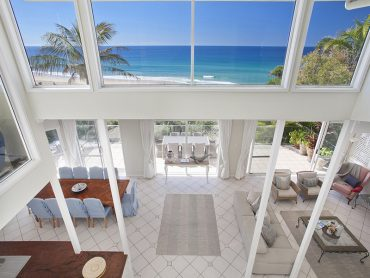 Inside view of 62 Tingria open plan living and through the windows to the ocean