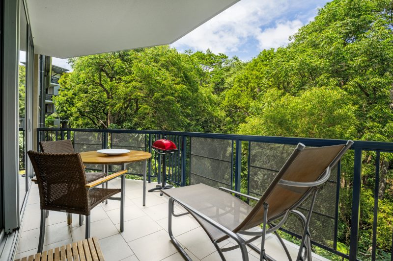 Seats on the balcony looking at trees in Viewland Drive Noosa