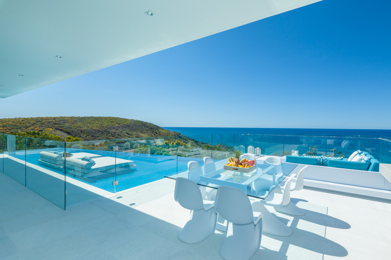 Pool beds looking out onto sea