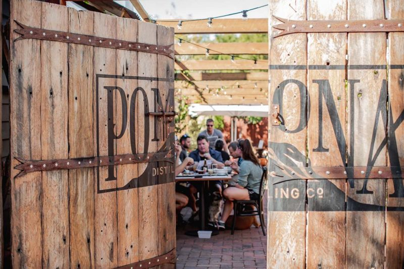 People sat behind the entrance doors to Pomona Distillery