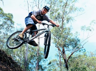 Person riding a mountain bike in the noosa hinterland